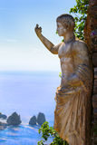 Roman statue andThe Faraglioni Rock formations Stock Photo