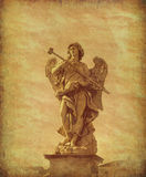Roman Statue. Angel statue on the bridge near castlel Sant Angelo in Rome, Italy. Grunge and retro style Stock Images