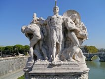 Roman statue. Rome, statue of ancient Roman soldier with prisoners on bridge over the Tiber Royalty Free Stock Photo