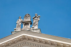 Roman statues on a roof Royalty Free Stock Photography