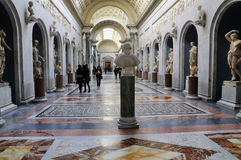 Roman Statues in the Vatican Museum. A gallery filled with Roman statues inside the Vatican Museums in Rome, Italy Stock Photo