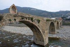 Roman stone Bridge in Taggia Stock Image