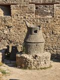 Ruins of Pompeii, ancient Roman city. Pompei, Campania. Italy. A roman stone hand mill & x28;mola asinaria& x29; of a bakery at Ruins of Pompeii. The city was Royalty Free Stock Photos