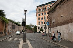 Roman street with paving stones on a cloudy day. Rome, Italy - August 16, 2015: Roman ancient street with paving stones on a cloudy day Royalty Free Stock Images