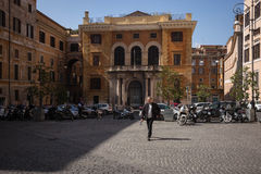 Roman street scene with man walking. Royalty Free Stock Photography