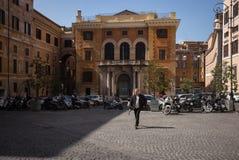 Roman street scene with man walking. Street scene, Rome, Italy, man walking across parking lot Royalty Free Stock Photography