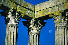 Roman structures with the moon in the sky Royalty Free Stock Photography