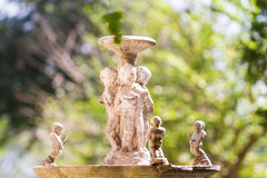 Roman style fountain in garden Royalty Free Stock Photo