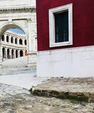 Roman style old vintage path around a modern. Red house Royalty Free Stock Image