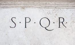 Roman symbol sign SPQR on white marble. Roman symbol sign SPQR, Italian architecture detail on white marble Stock Image