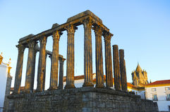 Roman temple of Diana and the dome of Cathedral at sunset, Evora, Portugal Royalty Free Stock Photo