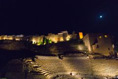 Roman Theater and Alcazaba in Malaga at night. Andalusia, Spain stock photos