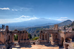 Roman theater, vulcaono etna, Taormina, Sicily, Italy. The stage of the Roman theatre in Taormina, Sicily, Italy, with the Etna Vulcano mountain on the stock photography