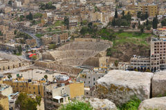 Roman Theatre in Amman, Jordan. Amman, Jordan - March 17, 2014: View to the Roman Theatre from the Citadel hill. Built in the II century, it could seat about 6 Stock Image