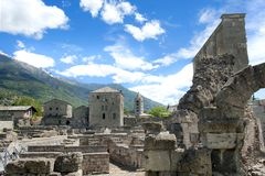 Roman Theatre, Aosta. Roman Theater, Aosta in the Valle D'Aosta with at background old church Royalty Free Stock Image