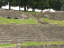 Roman theatre in Autun. Benches  and steps at old Roman theatre in Autun, France. Biggest roman theatre in france. It was build during the reign of Emperor Stock Photography