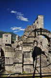 Roman theatre ruins in the city of Aosta, Italy. Royalty Free Stock Photo