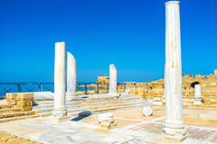 The Roman Thermae. The ruins of the Roman Thermae, the large bath complex, located on the coast in Caesarea, Israel stock photo