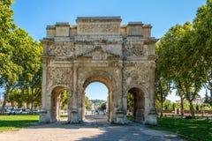Roman Triumphal Arch antique d'orange - France Image stock
