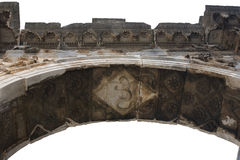 Roman triumphal arch isolated. Roman triumphal arch (Arch of Sergii) in Pula, Croatia. Fragment, islated on white Stock Images