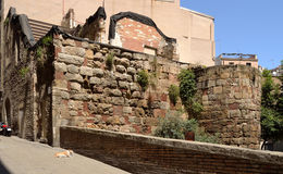 Roman Wall, Barcelona. Tower and fragment of the Roman wall of Barcelona Royalty Free Stock Photos