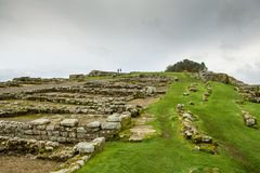 The Roman Wall at Housesteads. A stretch of Hadrians Wall at Housesteads, near Hexham, in Northumberland, England. The Wall was built by the Emperor Hadrian in stock images
