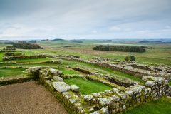 The Roman Wall at Housesteads. A stretch of Hadrians Wall at Housesteads, near Hexham, in Northumberland, England. The Wall was built by the Emperor Hadrian in stock photos