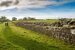 The Roman Wall. A stretch of Hadrians Wall at Birdoswald, near Hexham, in Northumberland, England. The Wall was built by the Emperor Hadrian in 122 AD and royalty free stock photo