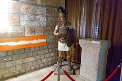 Roman warrior dummy and a old column. In Union Museum from Alba Iulia, Romania Stock Image