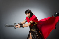 The roman warrior with sword against background. Roman warrior with sword against background Royalty Free Stock Image