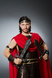 The roman warrior with sword against background. Roman warrior with sword against background Royalty Free Stock Photography