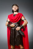The roman warrior with sword against background Stock Photo