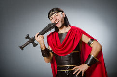 The roman warrior with sword against background. Roman warrior with sword against background Royalty Free Stock Photo