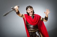 The roman warrior with sword against background. Roman warrior with sword against background Royalty Free Stock Images