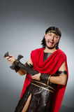 The roman warrior with sword against background. Roman warrior with sword against background Stock Image