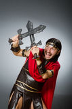 The roman warrior with sword against background. Roman warrior with sword against background Stock Photos