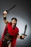 Roman warrior with sword against background Royalty Free Stock Image
