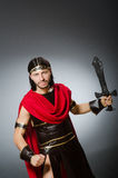 Roman warrior with sword against background. The roman warrior with sword against background Royalty Free Stock Photo