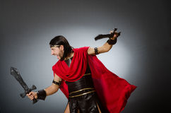 Roman warrior with sword against background. The roman warrior with sword against background Stock Photos