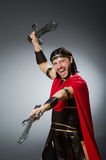 Roman warrior with sword against background. The roman warrior with sword against background Stock Photo