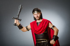 Roman warrior with sword against background. The roman warrior with sword against background Stock Images
