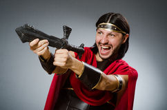 The roman warrior with sword against background. Roman warrior with sword against background Stock Photo