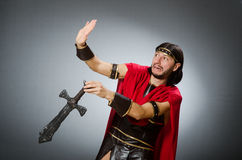 The roman warrior with sword against background. Roman warrior with sword against background Stock Images