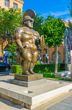 The Roman Warrior in Yerevan. YEREVAN, ARMENIA - MAY 29, 2016: The Roman Warrior by F Botero is represented by Cafesjian Center for Art in sculpture garden in Royalty Free Stock Photos