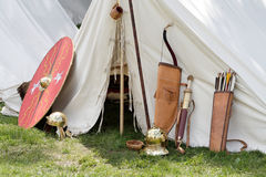 Roman weapons. Ancient roman weapons and helmets in front of a tent Royalty Free Stock Photo
