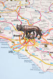 The Roman she-wolf on an Italy map Stock Image