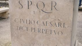 Roman writing and bas-reliefs imperial era archeology italy. Stock. SPQR inscription on the wall.  stock video