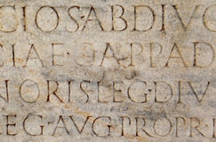Roman Writing at Ephesus, Turkey. Roman writing carved into stone at Ephesus archeological site in Turkey Royalty Free Stock Images