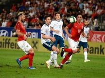 Roman Zobnin contre les joueurs autrichiens Aleksandar Dragovic, Sebastian Prodl et Peter Zulj images libres de droits
