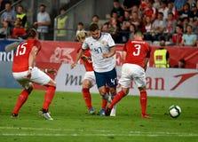 Roman Zobnin tegen Oostenrijkse spelers Aleksandar Dragovic en Peter Zulj royalty-vrije stock afbeelding